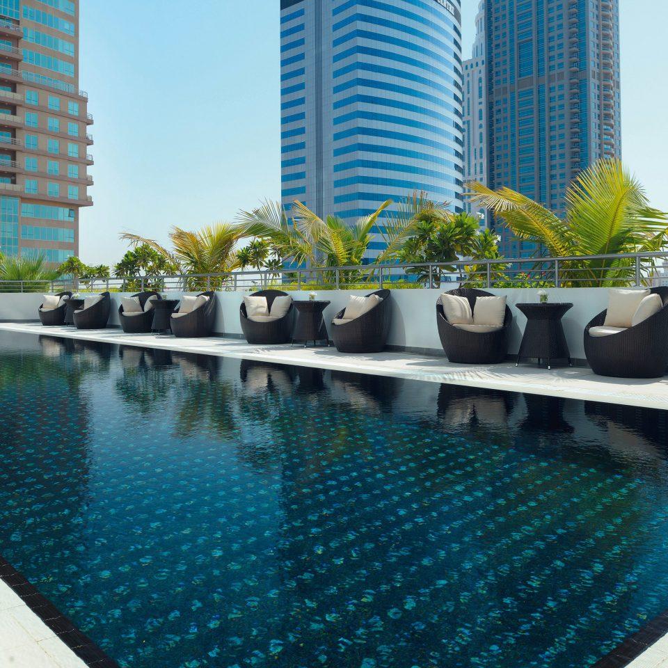 water condominium swimming pool Pool property leisure reflecting pool Resort swimming lined