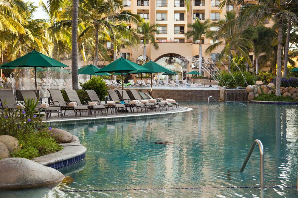 tree swimming pool Resort reflecting pool resort town palace condominium Pool water feature
