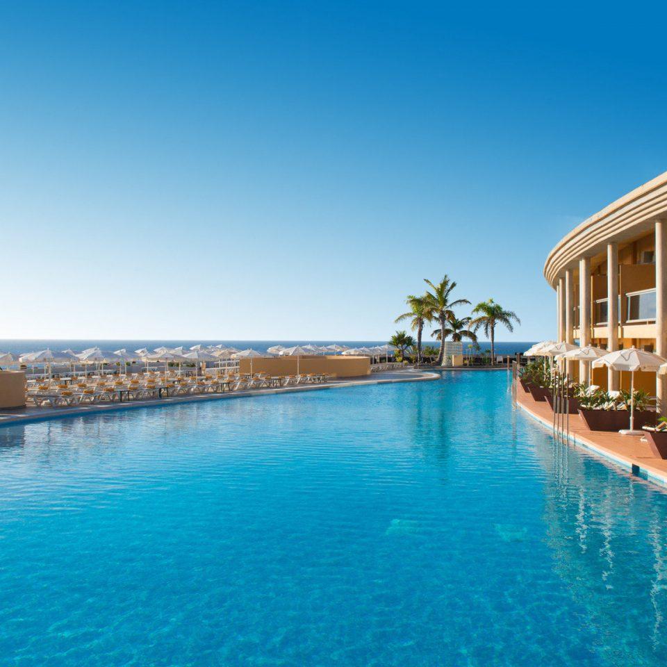 water sky swimming pool leisure property Resort Pool resort town condominium blue Sea marina caribbean swimming