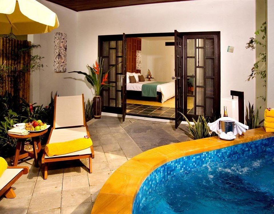 property swimming pool Villa yellow home Suite living room cottage condominium Pool Resort hacienda
