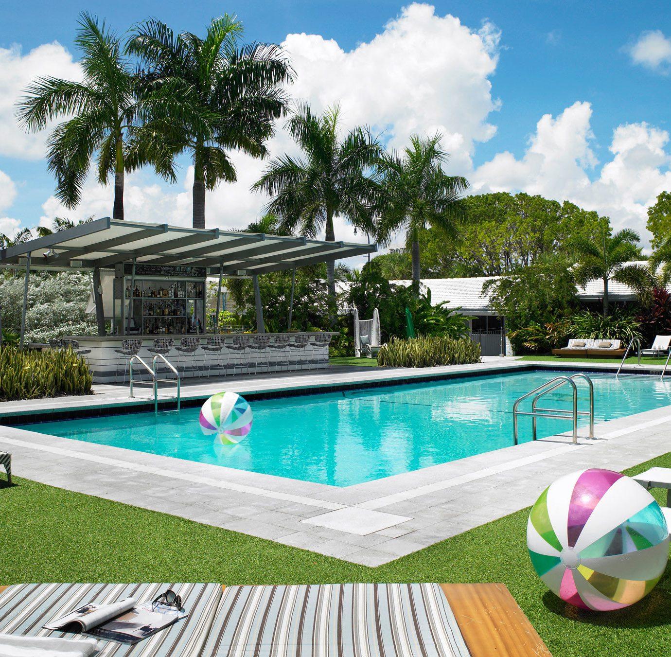 Trip Ideas tree grass swimming pool leisure property Villa backyard Resort green home condominium Pool park mansion