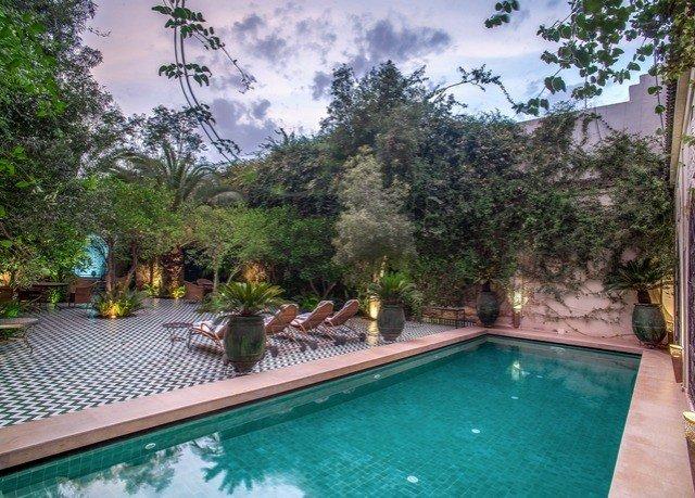 tree property swimming pool Resort leisure plant backyard outdoor structure Villa hacienda house amenity Pool resort town yard