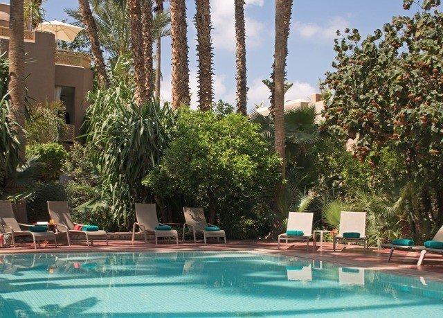 tree property Resort swimming pool leisure Pool condominium Villa home hacienda resort town amenity swimming