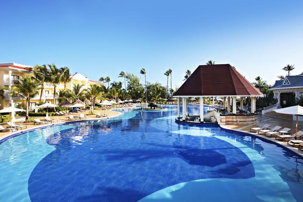 sky water Pool Resort swimming swimming pool house property leisure aquatic mammal resort town lawn reef Villa dolphin