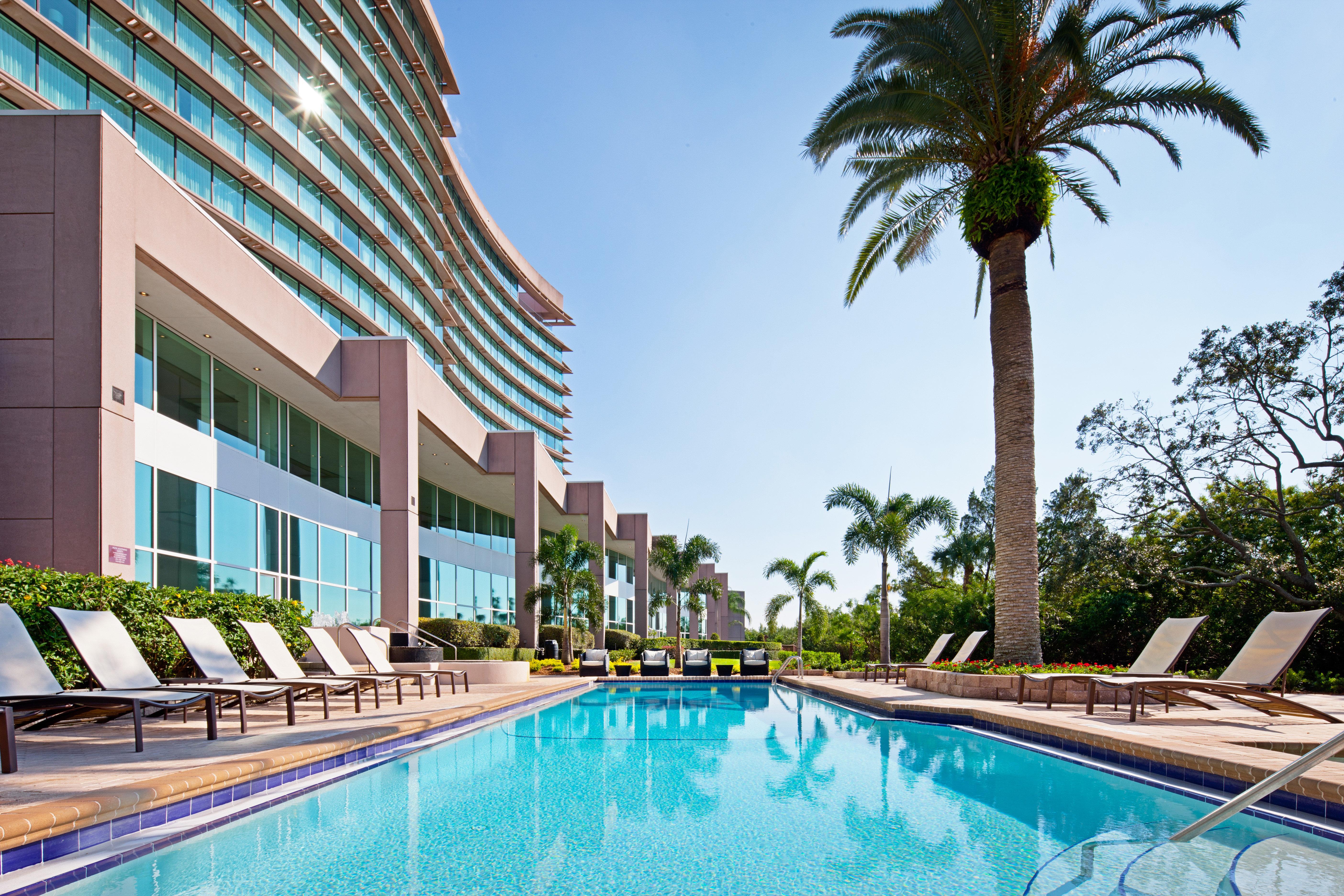 building Resort Pool swimming pool leisure condominium property plaza arecales Villa palm lined swimming