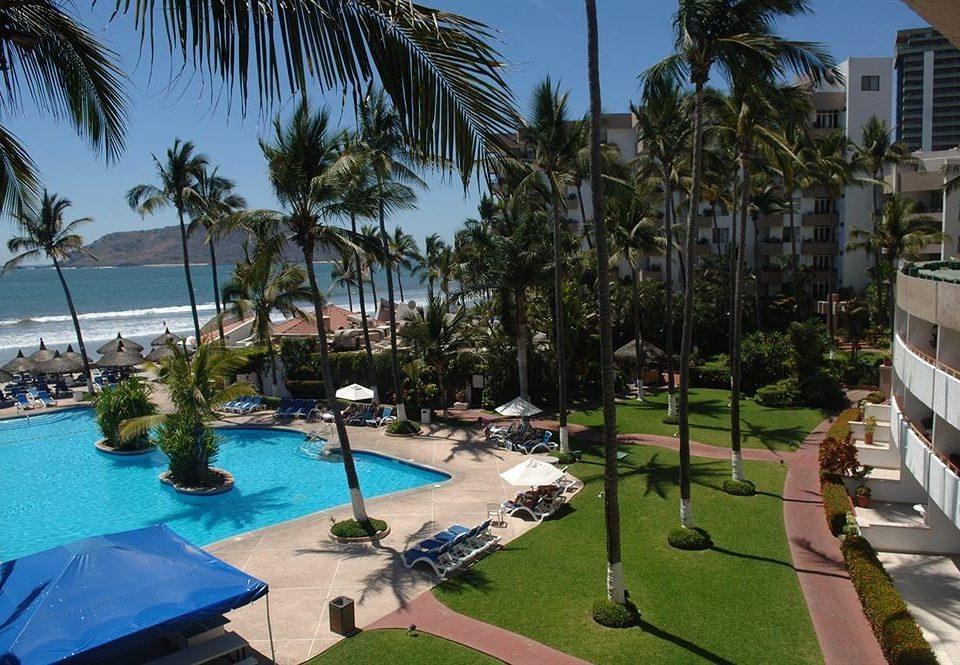 tree sky palm Resort property leisure swimming pool condominium marina arecales Pool Villa lined plant