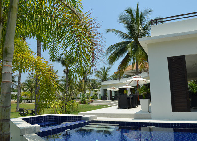 tree sky palm swimming pool property condominium Resort Villa arecales home Pool caribbean plant