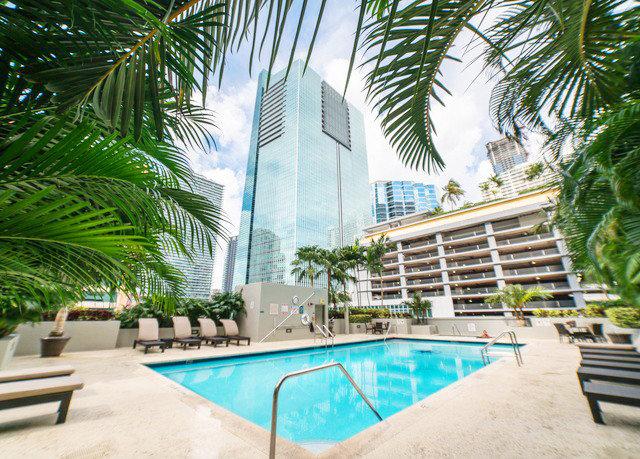 tree palm park swimming pool leisure property Resort condominium Pool plant arecales caribbean home palm family Villa tropics lined shade