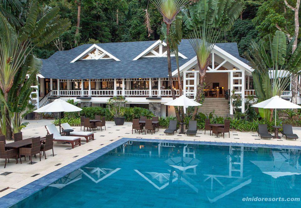 tree ground swimming pool property building Resort leisure Villa house home Pool cottage condominium backyard mansion eco hotel swimming