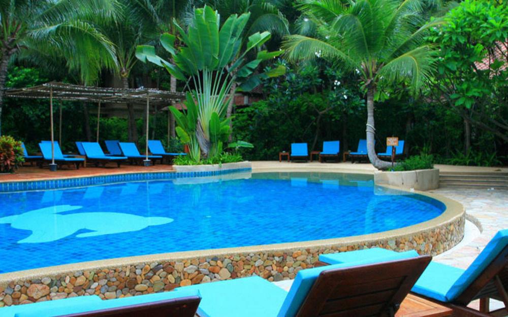 tree Pool swimming pool property Resort leisure blue backyard Villa plant swimming colored