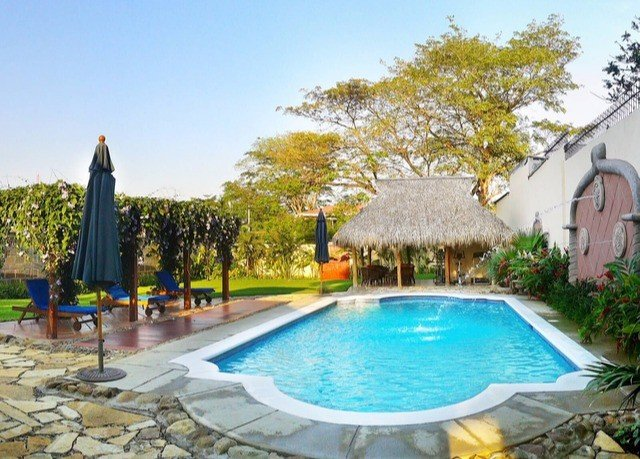 tree sky swimming pool property leisure Pool Villa backyard Resort lawn cottage blue