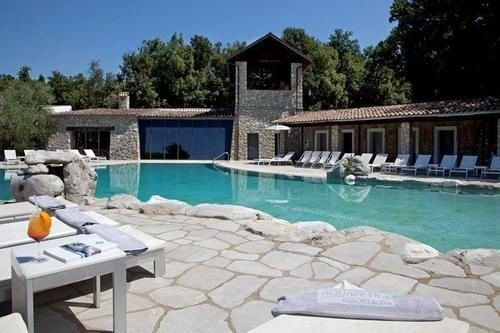 tree swimming pool property Villa building Resort Pool condominium cottage hacienda backyard stone
