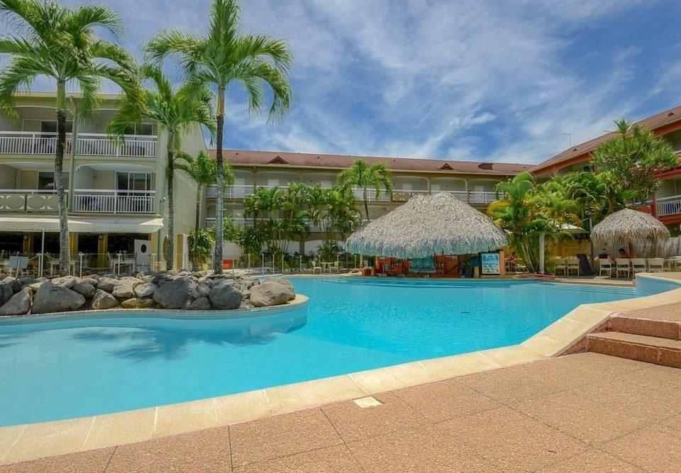 building water Pool swimming pool Resort property leisure condominium Villa resort town backyard mansion blue hacienda swimming