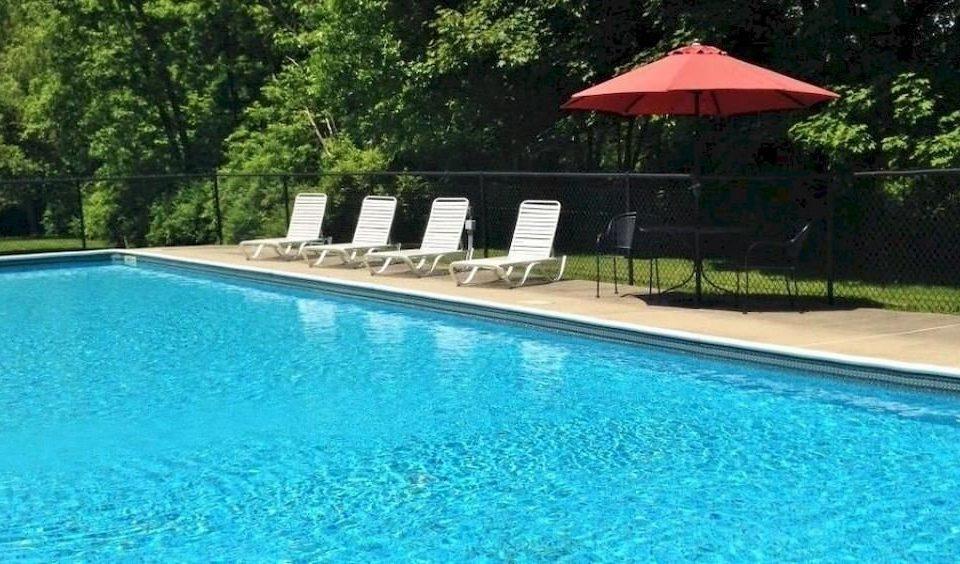 tree water Pool umbrella swimming swimming pool property Resort Villa backyard lawn blue pond