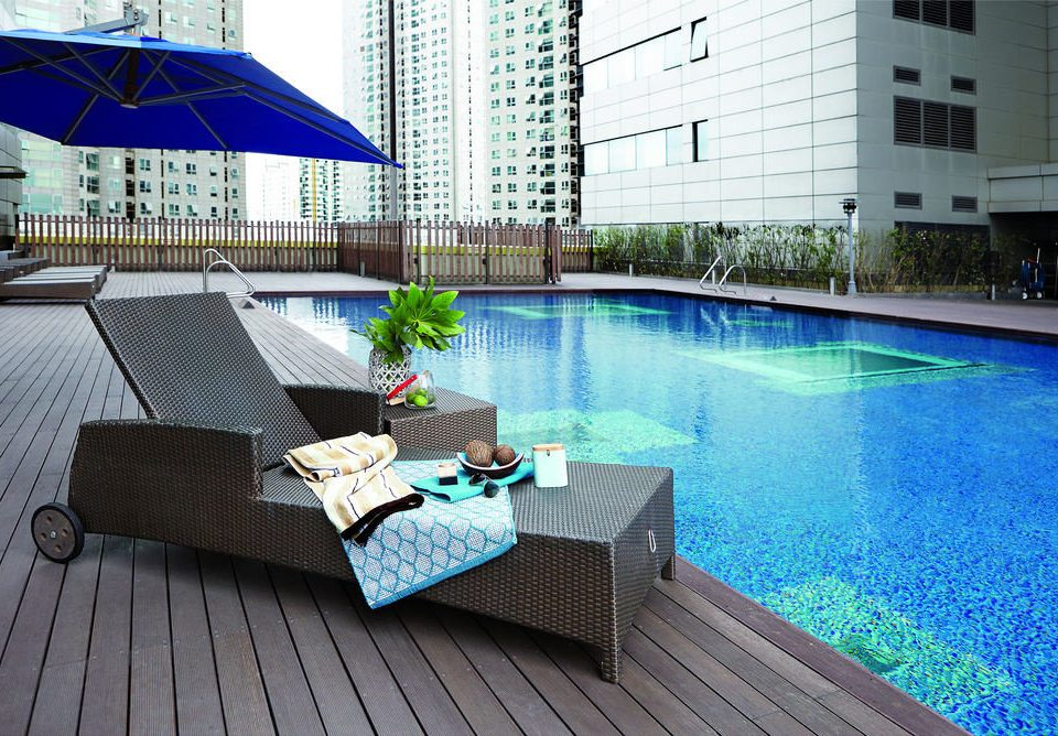 swimming pool property leisure condominium backyard reflecting pool Villa outdoor structure Resort blue Pool