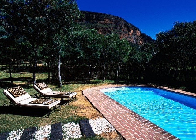 tree sky swimming pool property leisure backyard Villa Resort Pool lawn