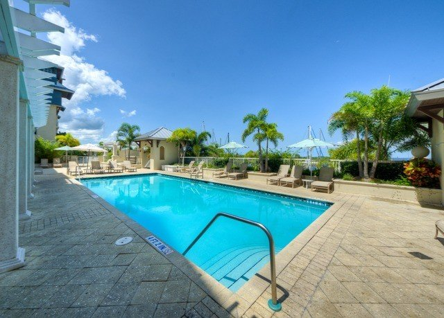 sky ground swimming pool property Resort leisure condominium Villa sidewalk caribbean Pool blue backyard