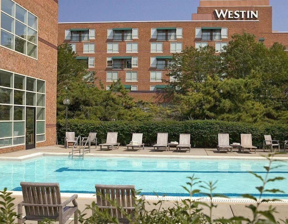 Pool building property condominium swimming pool home residential area Resort backyard Villa plaza