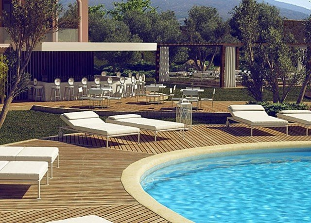 tree swimming pool chair property Pool backyard reflecting pool Villa outdoor structure Resort home mansion condominium swimming