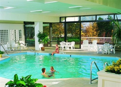 swimming pool Resort leisure building property chair Pool condominium leisure centre green Villa backyard eco hotel plant swimming