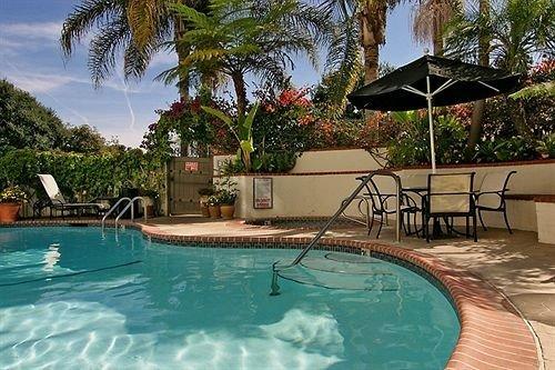 tree water Pool Resort swimming pool property leisure Villa backyard condominium palm empty swimming