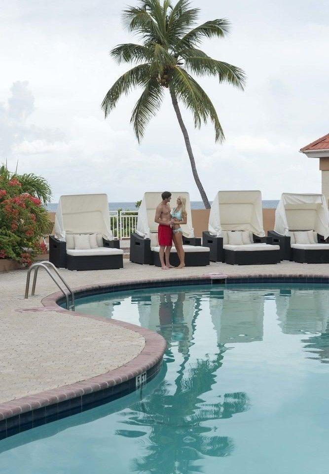 water swimming pool leisure property Resort condominium reflecting pool Villa Pool backyard palm plant