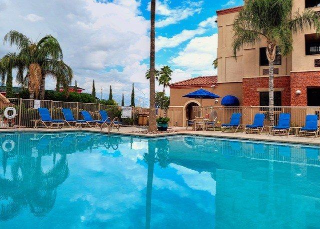 Pool swimming pool property leisure Resort building resort town Villa condominium blue mansion hacienda backyard swimming