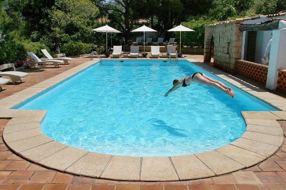 tree ground Pool swimming pool property leisure backyard swimming blue Villa Resort paving