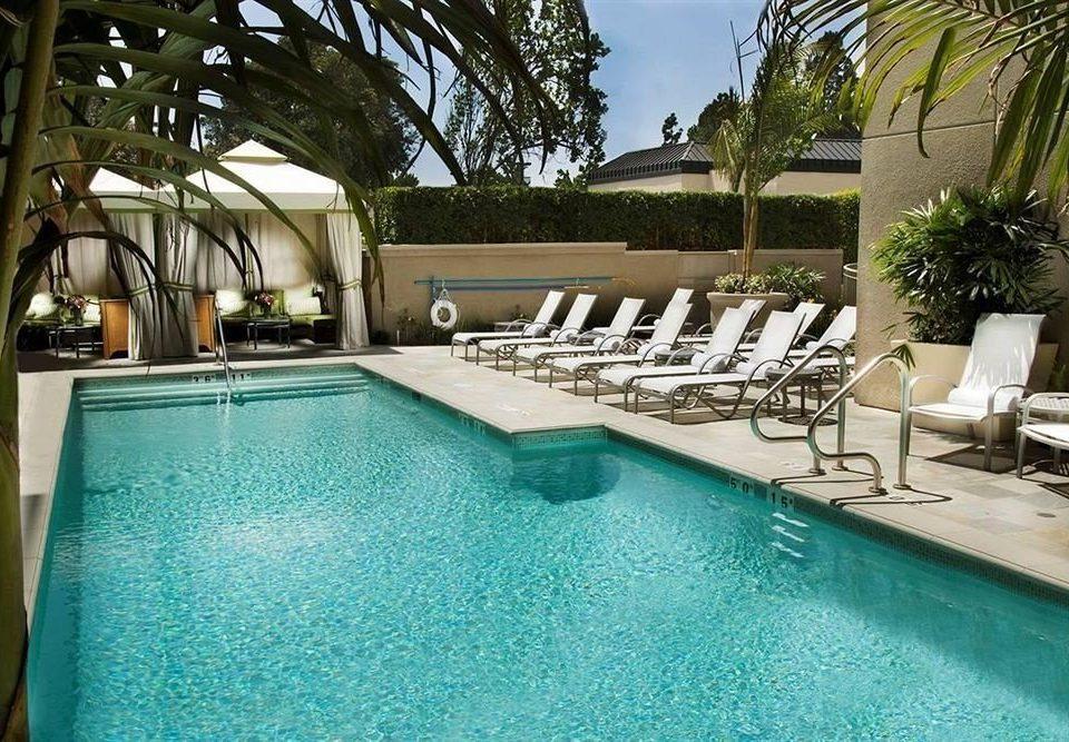 tree Pool swimming pool property leisure Resort Villa building backyard home condominium mansion hacienda blue swimming palm