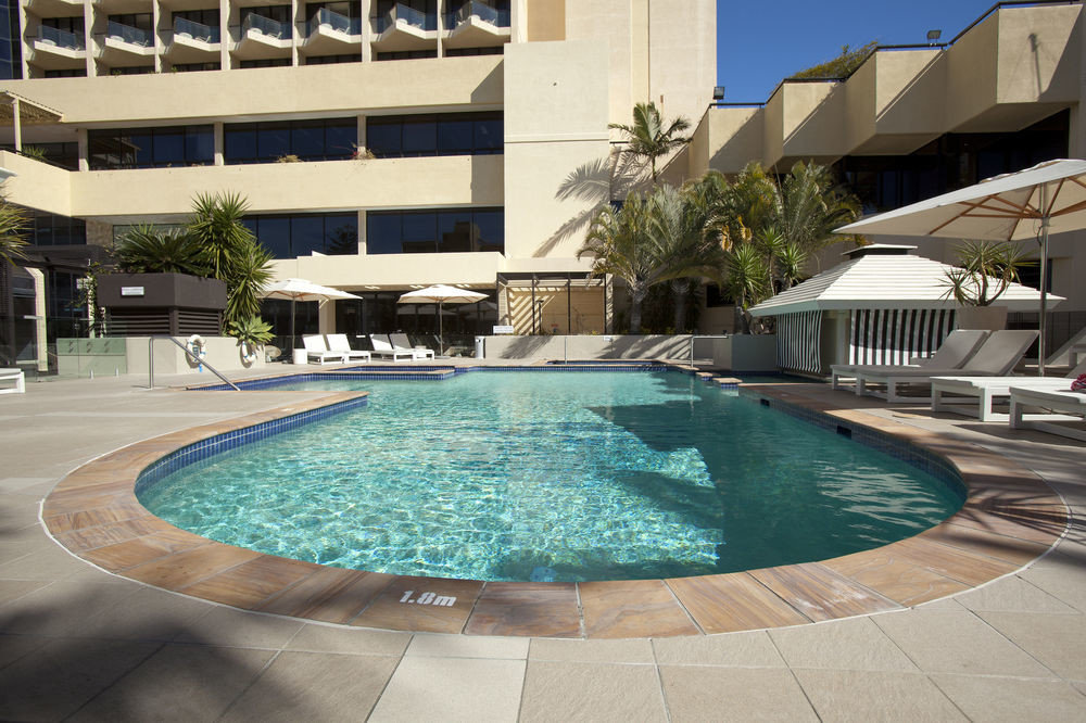 ground building Pool swimming pool property Resort leisure condominium reflecting pool backyard Villa blue mansion swimming