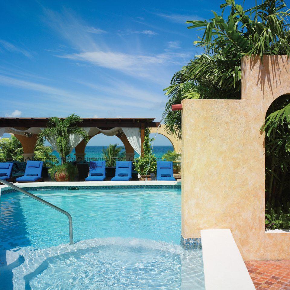 swimming pool property leisure building Pool Resort Villa house home hacienda backyard mansion blue stone