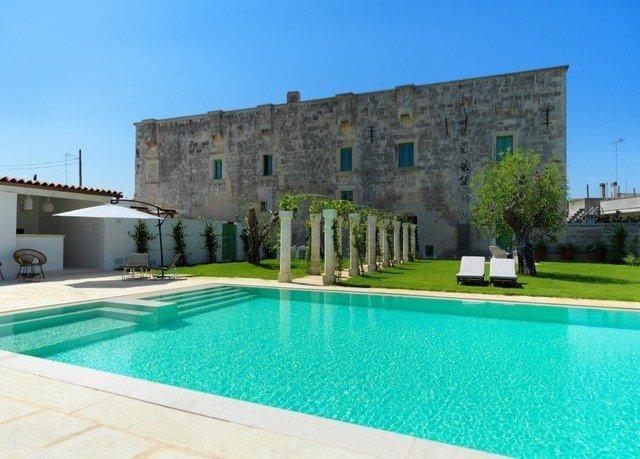sky building Pool property swimming pool Villa blue reflecting pool mansion condominium swimming Resort