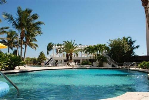 sky tree water palm Resort Pool swimming pool property Villa condominium caribbean resort town blue swimming reef lined shore