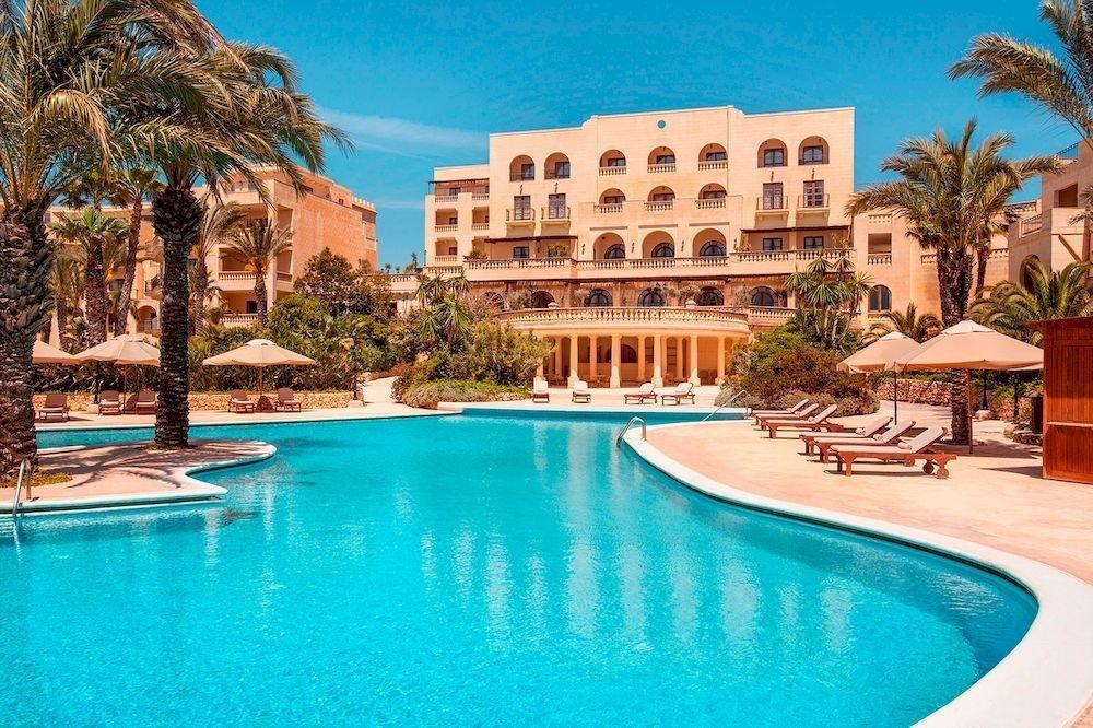 Resort Pool tree water swimming swimming pool property leisure condominium blue Villa resort town palace mansion palm empty