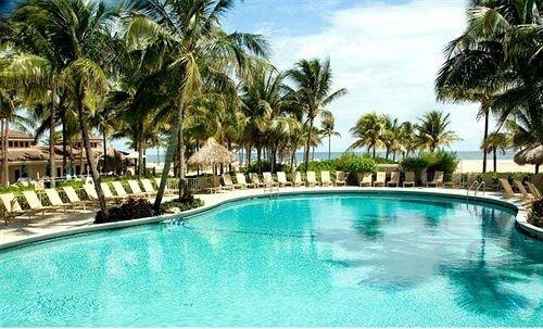 Resort water tree Pool sky palm swimming pool swimming property water sport leisure caribbean Villa resort town condominium lined blue reef empty