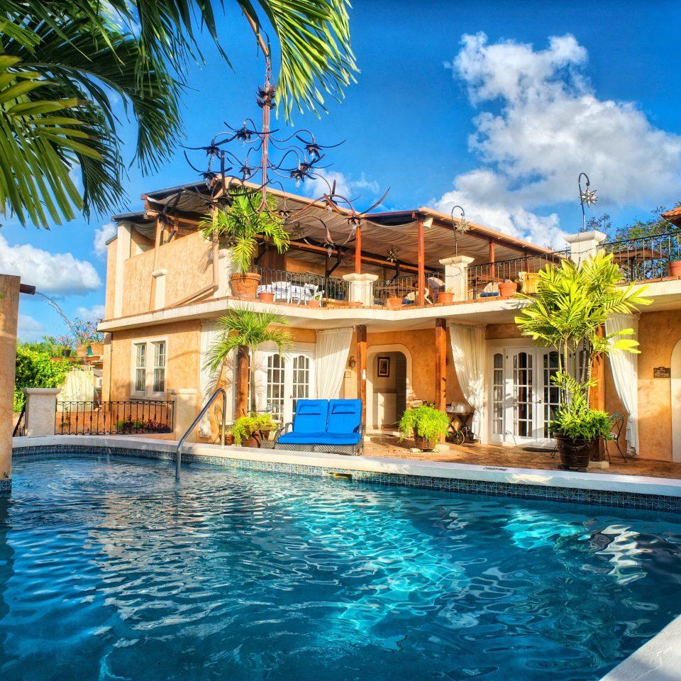 building sky Resort Pool tree water swimming pool property leisure Villa caribbean blue mansion home condominium resort town hacienda eco hotel swimming