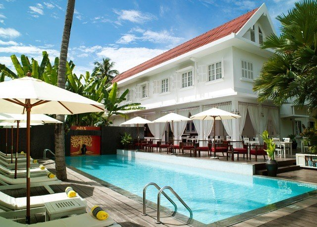 sky building swimming pool property leisure Resort condominium Pool Villa caribbean home resort town hacienda mansion eco hotel blue swimming