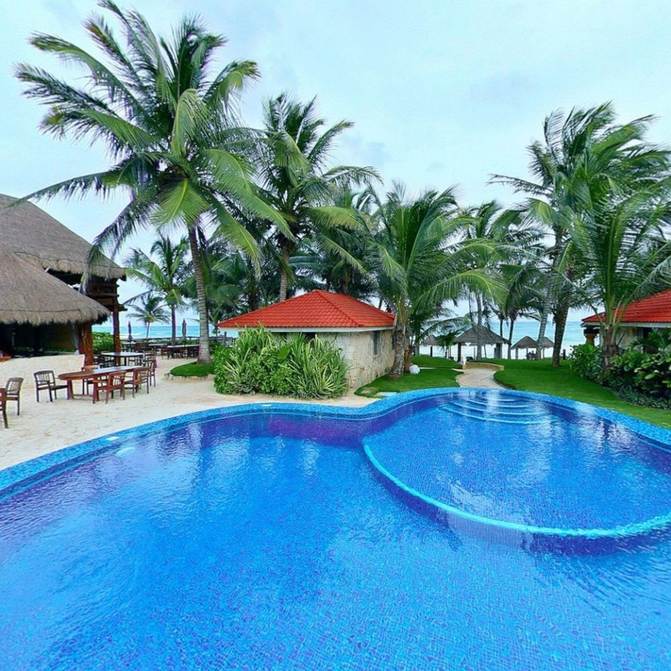 tree Pool sky water Resort swimming pool swimming property building leisure Villa blue resort town condominium caribbean