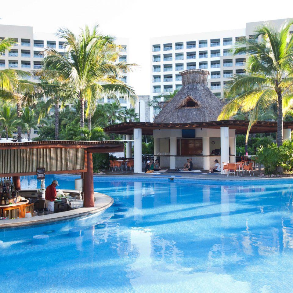 water Pool Resort tree swimming pool swimming property building leisure condominium resort town Villa eco hotel blue pond