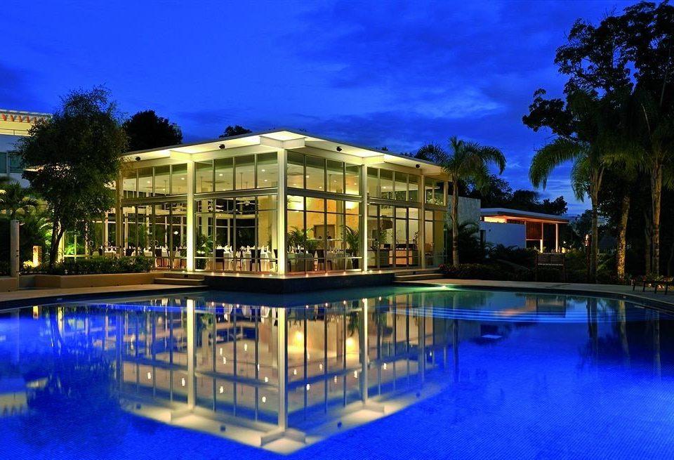 tree property swimming pool condominium Resort building reflecting pool home resort town mansion Pool Villa blue