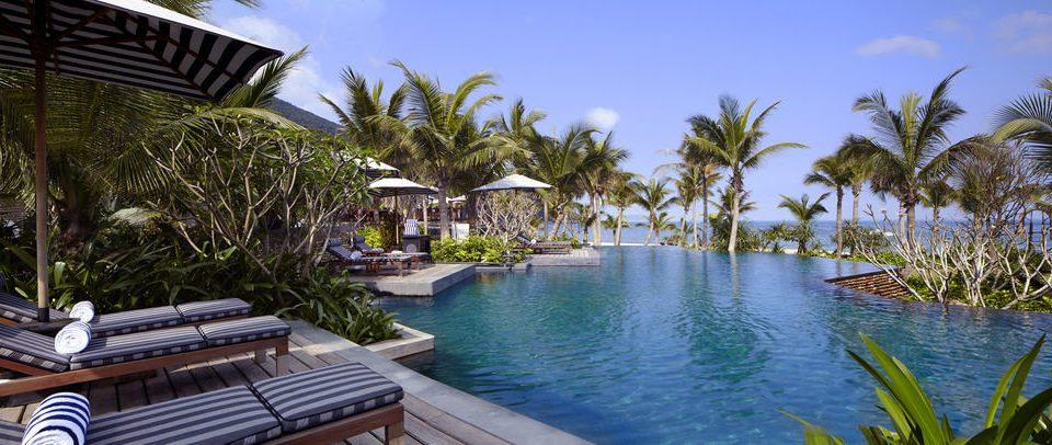 tree water property Resort swimming pool resort town Villa palm Pool caribbean condominium eco hotel surrounded