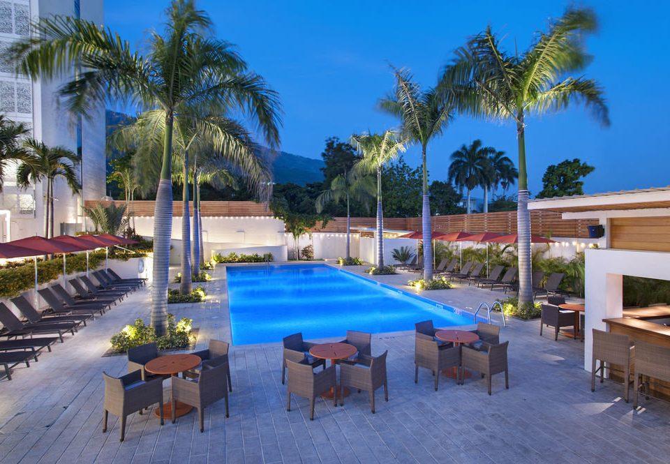 tree chair property Resort swimming pool leisure palm Villa Pool caribbean condominium hacienda