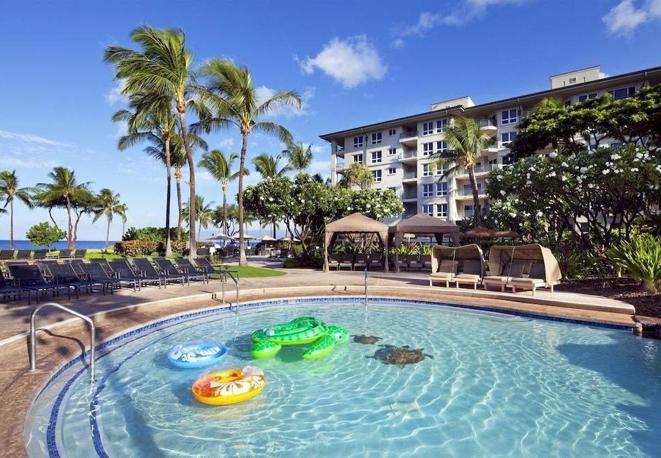 sky tree water Pool swimming pool Resort property leisure condominium resort town Villa mansion swimming