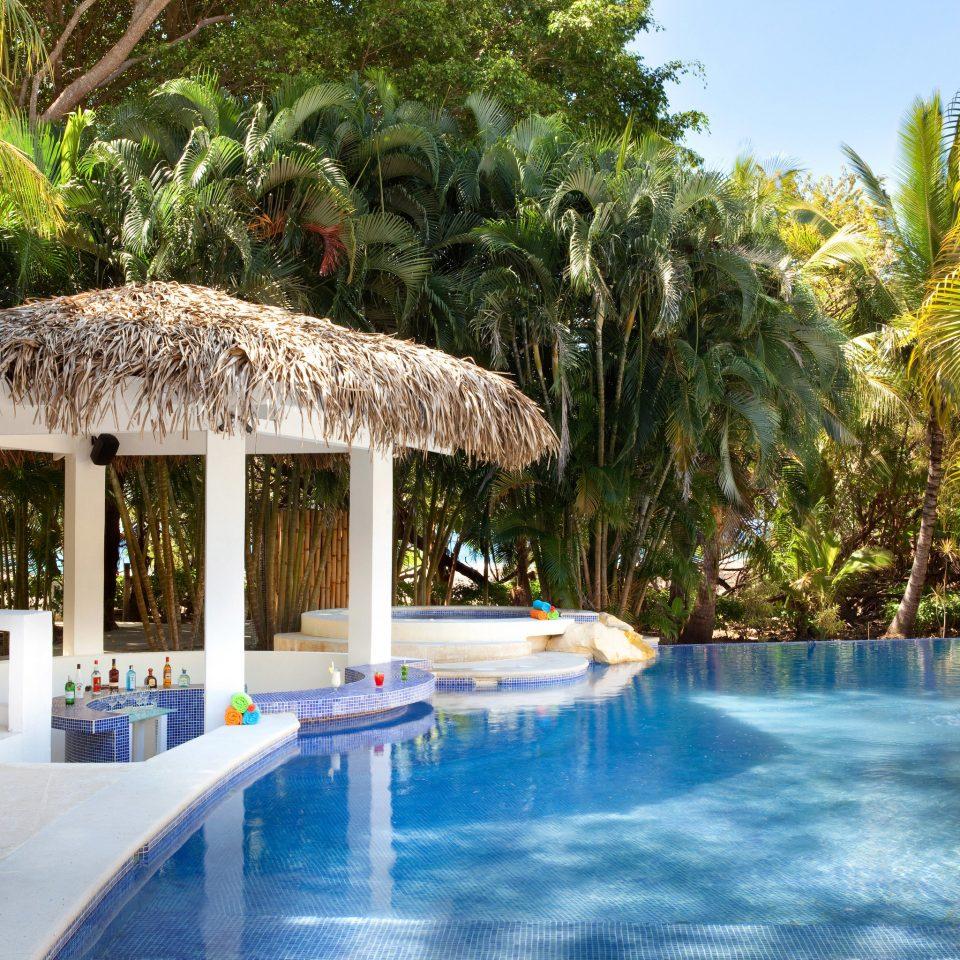 tree swimming pool leisure Resort property resort town Villa Pool eco hotel