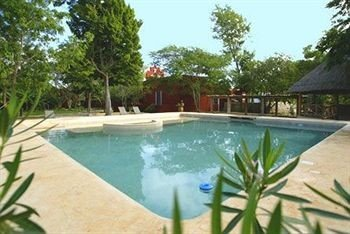 tree sky swimming pool Resort property palm Pool plant Villa lined shore