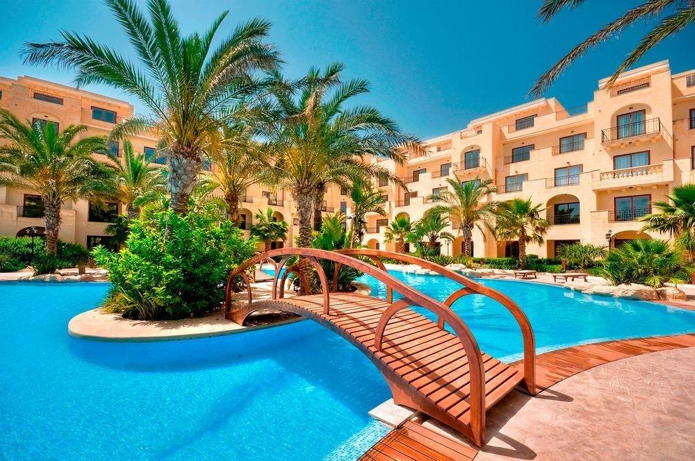 Resort tree sky swimming pool palm property leisure condominium Villa caribbean Pool resort town mansion Water park blue plant