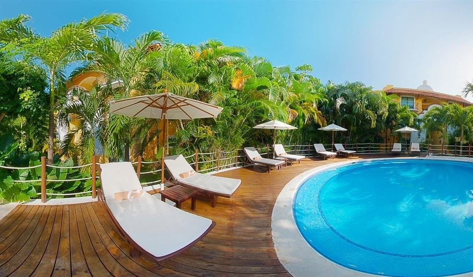 tree sky swimming pool leisure Resort property caribbean Pool Villa eco hotel Water park hacienda backyard set swimming