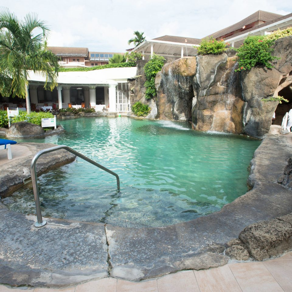 ground swimming pool property leisure rock backyard Pool Water park Resort water feature Villa stone concrete cement