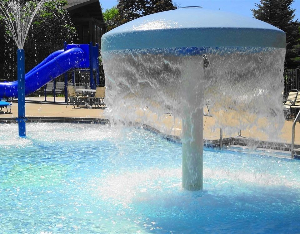 tree water swimming pool leisure Water park amusement park fountain blue park aquatic mammal water feature Pool Resort inflatable recreation dolphin