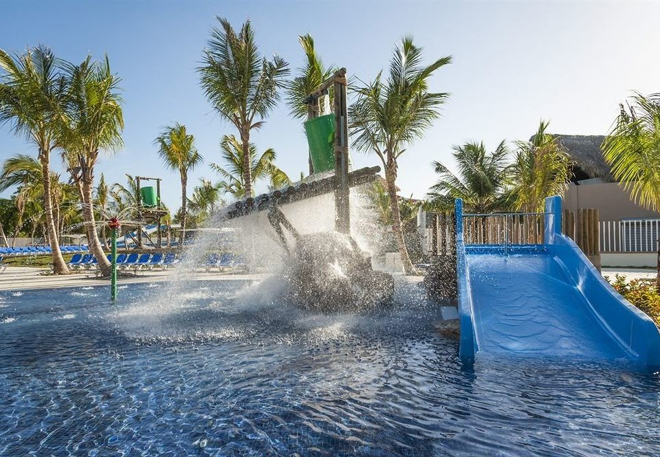 sky tree palm leisure swimming pool Water park water amusement park Resort park fountain blue Pool water feature shore